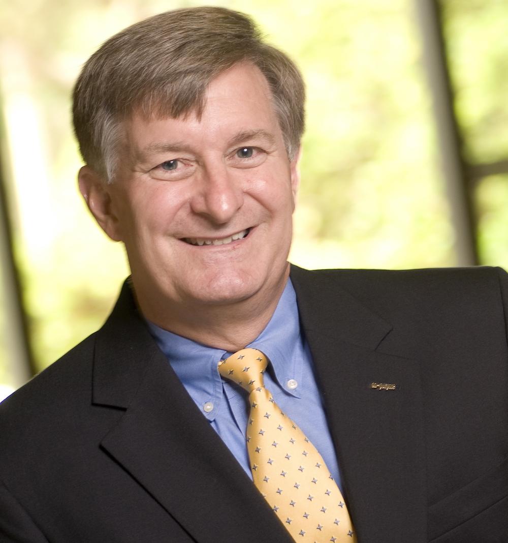 Kevin W. McCarthy headshot in tie